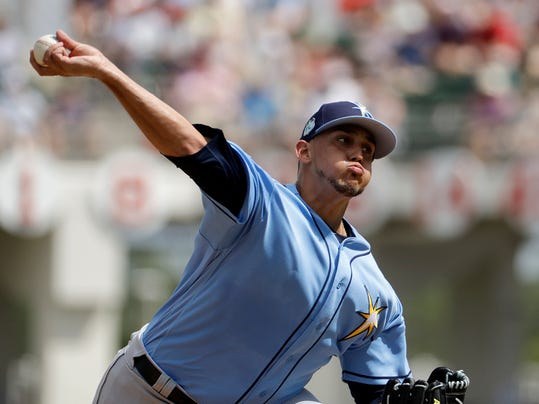 FILE - In this March 2, 2017, file photo, Tampa Bay Rays starting pitcher Jose De Leon throws in the first inning of a spring training baseball game against the Boston Red Sox in Fort Myers, Fla. De Leon has a torn ulnar collateral ligament in his right elbow. The team said Wednesday, March 7, 2018, on Twitter that he will be examined by Dr. James Andrews. The 25-year-old De Leon is the second top Rays prospect to incur a major elbow injury this spring training. (AP Photo/David Goldman, File)