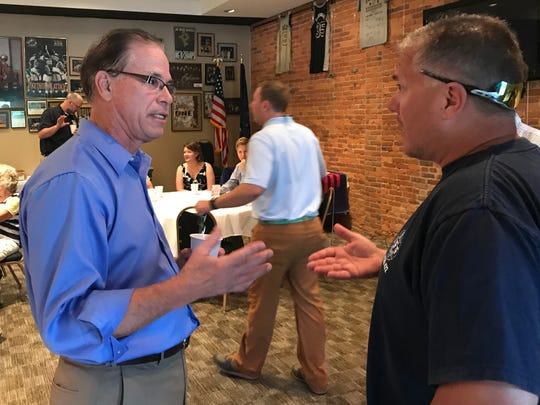 Mike Braun, Republican candidate for U.S. Senate, works the room during a campaign stop Tuesday at Preston's in downtown Lafayette.