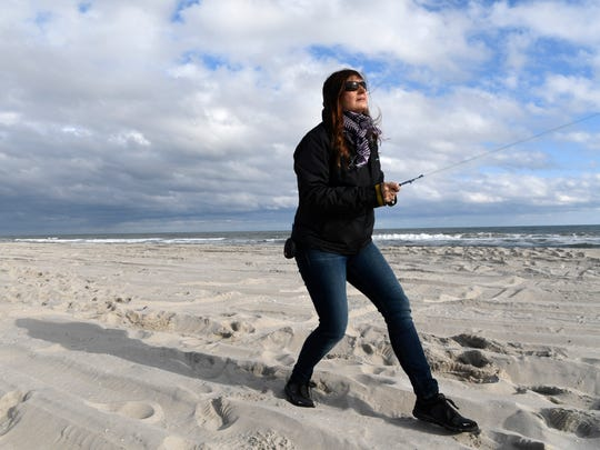 """Lisa Willoughby is one of the few women to compete at a high level in the male-dominated sport of competitive kite flying. """"I've had a top kite flier say, 'You have kids here. Why are you doing this?' """" she said. """"Another kite flier said, 'If you just did one thing, you'd actually be good at it.' """""""
