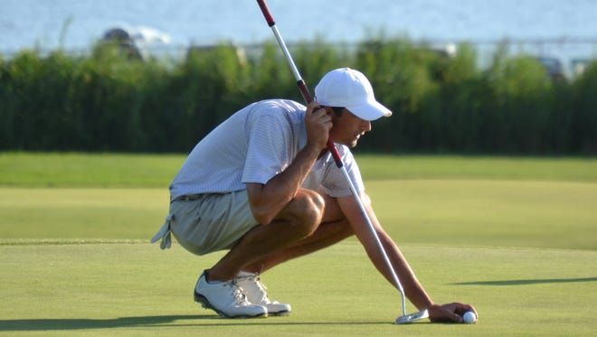 Stewart Hagestad lines up a birdie putt on the ninth hole Thursday at the Country Club of Fairfield.