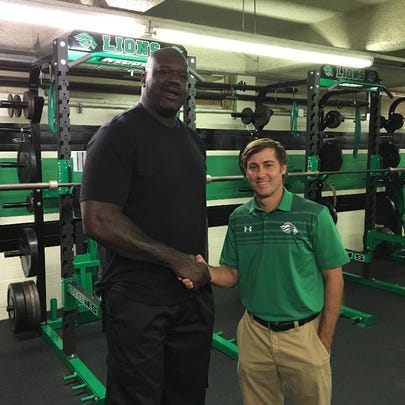 Shaquille O'Neal poses with Lafayette High Coach Rob