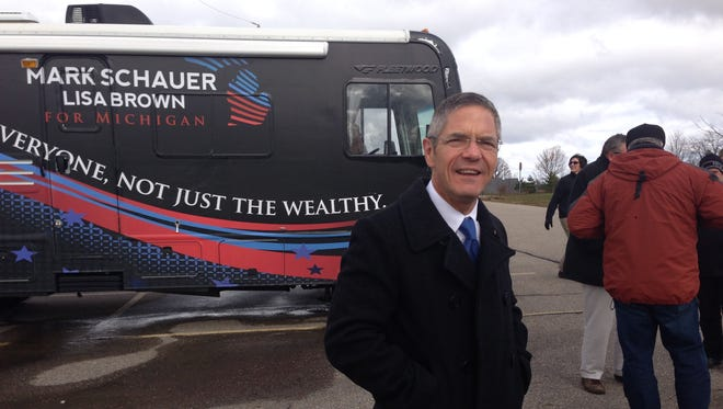 Mark Schauer stands in front of his campaign bus in Swartz Creek.