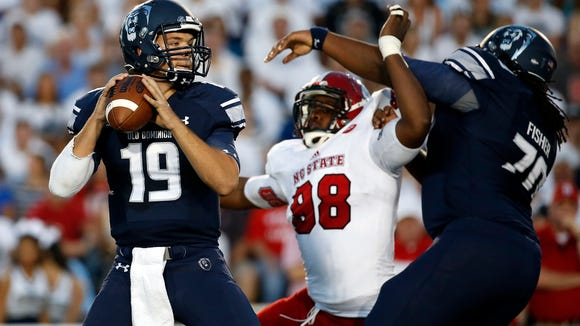 Old Dominion Monarchs quarterback Shuler Bentley (19) drops back to pass during the first quarter against the North Carolina State earlier this year.