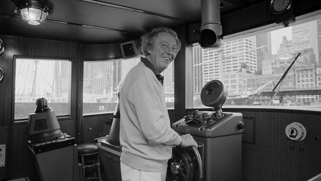 FILE - A Sept. 30, 1979 photo from files of pop impresario Robert Stigwood aboard his yacht Sarina as he readies to sail out of the South Street Seaport in lower Manhattan.