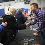 Minnesota Twins' Brian Dozier shakes hands with 93-year-old June Sawatzky, of Sioux Falls, during a Twins Winter Caravan event at Augustana University's Elmen Center Tuesday, Jan. 26, 2016, in Sioux Falls.
