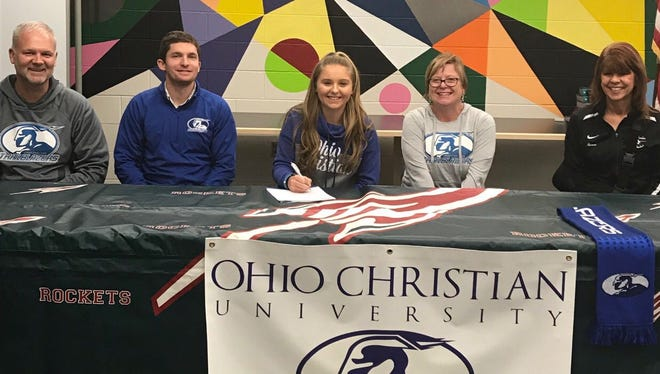 Oak Harbor's Seree Peterson will continue her soccer career at Ohio Christian. Petersen is joined by father Fred Petersen, OCU coach Jake Warren, mother Angela Petersen and Rockets coach Renee Williamson.