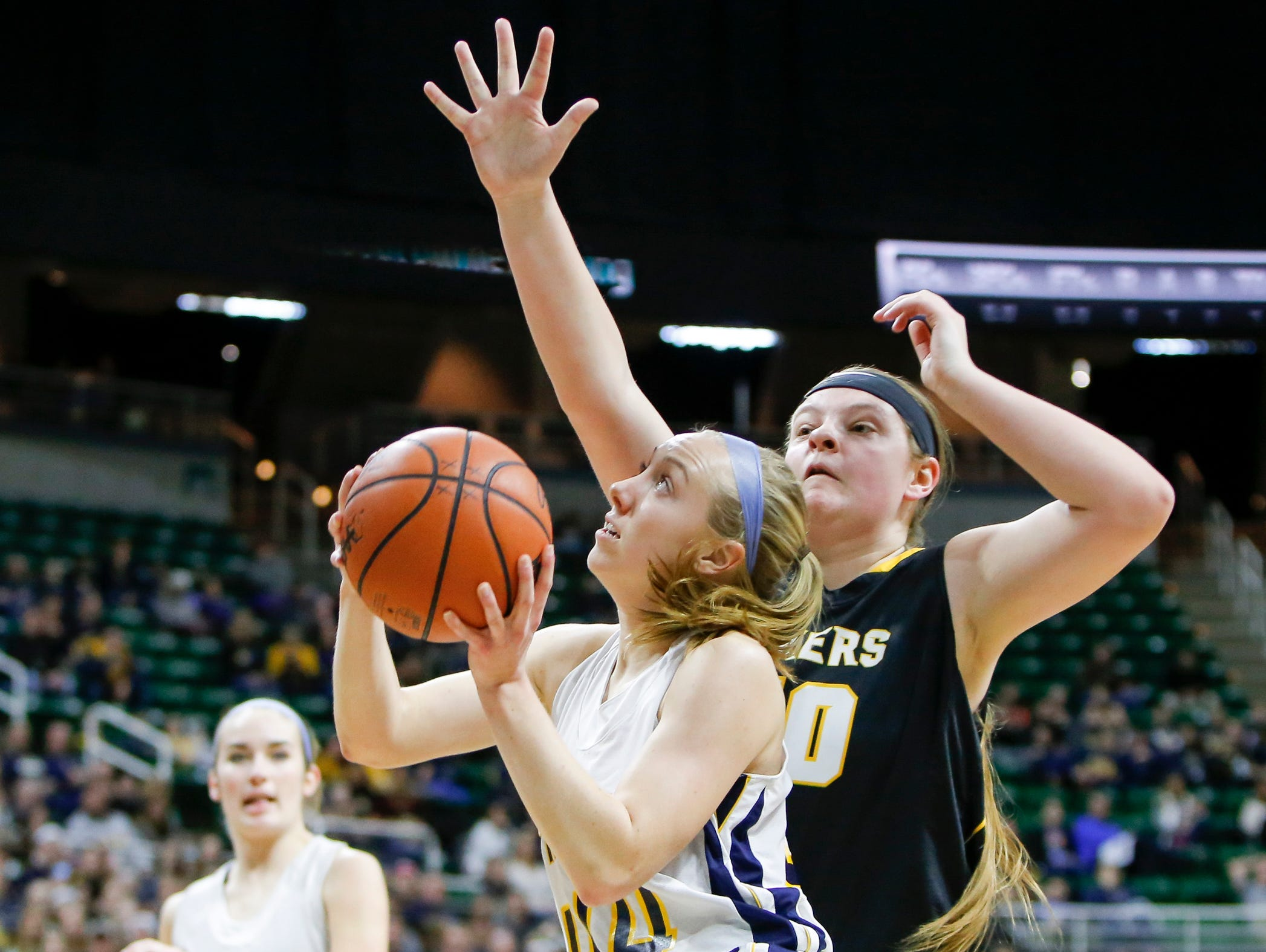 P-W's Brenna Wirth draws a foul against Maple City Glen Lake's Kaitlyn Schaub Thursday, March 16, 2017, during the Class B Semifinal at the Breslin in East Lansing. P-W won 64-51.