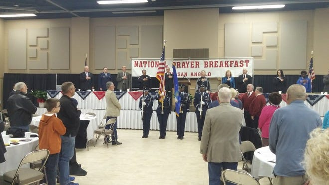 Federico Martinez/Standard-Times The Goodfellow Air Force Base Color Guard presents colors at San Angelo's National Prayer Breakfast held Thursday morning at the McNease Convention Center.