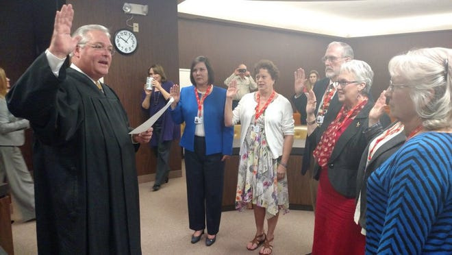 Inside his 326th District Court, Judge Paul Rotenberry swears in the latest volunteers of the Big Country Court Appointed Special Advocates for Children. These volunteers will serve as guardians in court cases for children who are going through the foster care system or involved in Child Protective Services cases.