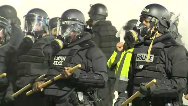 SWAT officers worked to keep the crowds back in Downtown Crossing in Boston.