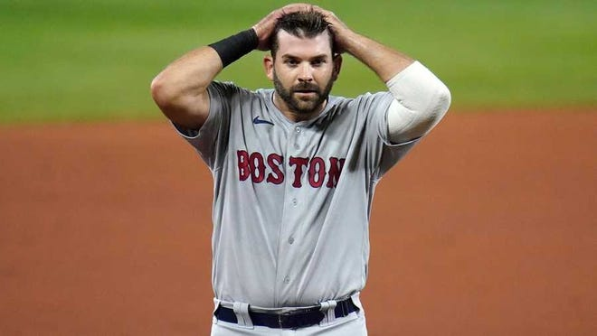 Boston Red Sox's Mitch Moreland heads to the dugout during the fifth inning of a baseball game against the Baltimore Orioles, Thursday, Aug. 20, 2020, in Baltimore.