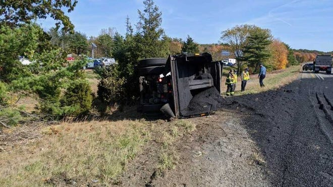 An asphault truck tipped over on I-495 in Wrentham.