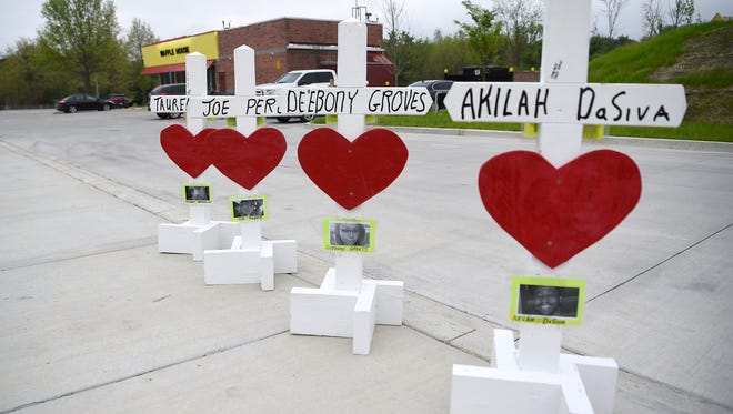 Crosses and hearts are placed in the parking lot at the Antioch Waffle House which reopened April 25, three days after a gunman killed four in Nashville, Tennessee.