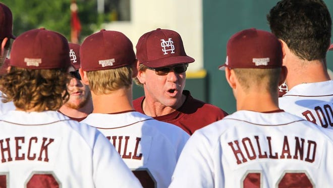 Mississippi State coach John Cohen speaks to his team prior to Thursday's game against LSU.