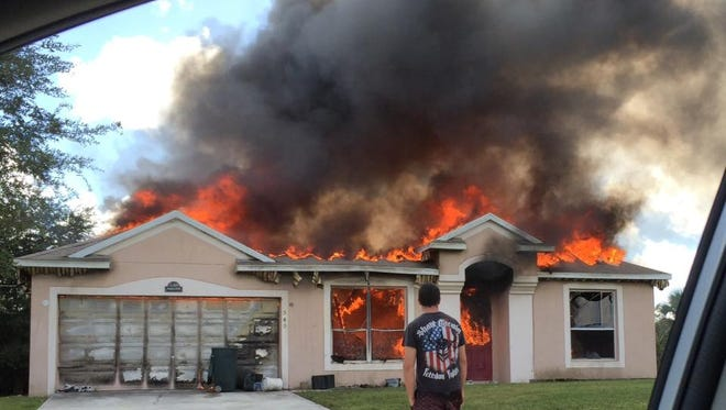 The scene of the house fire in Palm Bay.
