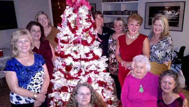 Tallahassee NAWIC members with Habitat Festival of Trees Donation