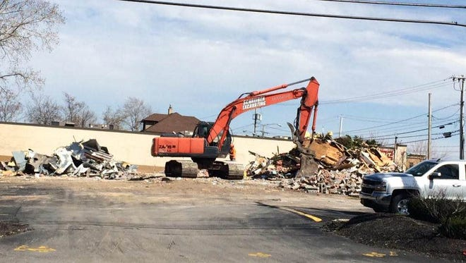 The old Bruegger's Bagels building in Irondequoit was torn down Tuesday.