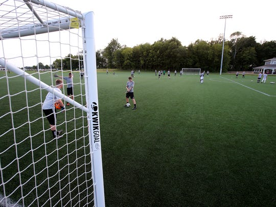 A soccer team utilizes a field for training at Grand Park, on Friday, August 14, 2014, in Westfield. The development of Grand Park and who will pay for it, has been a major issue between incumbent Republican Mayor Andy Cook and his primary challenger, Jeff Harpe, in the mayoral race.