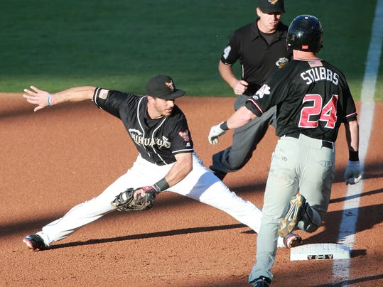 El Paso first baseman Tommy Medica stretches to touch first base in an attempt to put out hustling Albuquerque baserunner Drew Stubbs Wednesday. Umpire Nate White called Stubbs out.