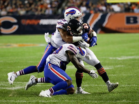 Chicago Bears running back Taquan Mizzell (33) is tackled