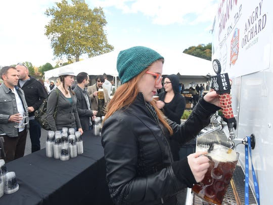 Cara Smith of Beacon serves beer during the Riverfront Oktoberfest held in the City of Poughkeepsie on Saturday.