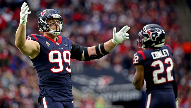 Houston Texans defensive end J.J. Watt celebrates during the first quarter of an AFC wild-card game against the Bills on Saturday.