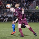 Sacramento Republic FC defender Derek Foran (2) heads the ball against San Jose Earthquakes forward Quincy Amarikwa on Feb. 20 in Sacramento.