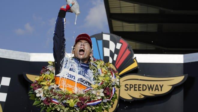 Takuma Sato celebrates after winning the Indianapolis 500 at Indianapolis Motor Speedway on Sunday.