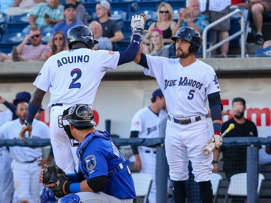 Pensacola's Aristides Aquino (2) gets a high five from