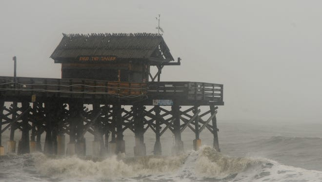 Big waves churned by Matthew lash the Cocoa Beach Pier on Friday, Oct. 7, 2016.