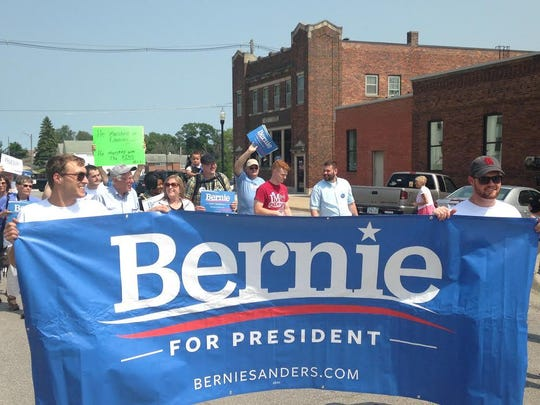 Supporters of Vermont Sen. Bernie Sanders gather in the staging area before the Denison Independence Day Parade on Friday afternoon.