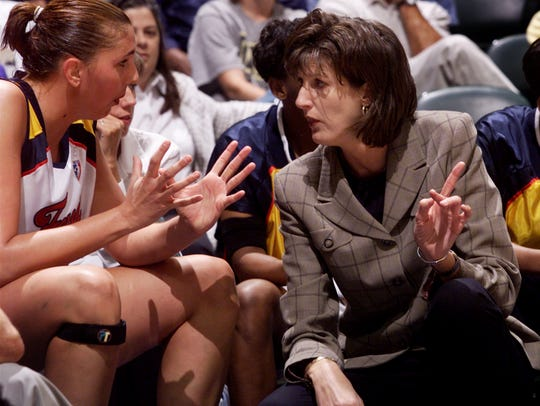 Indiana Fever coach Anne Donovan spoke with center Kara Wolters on the bench during preseason play against Sacramento.