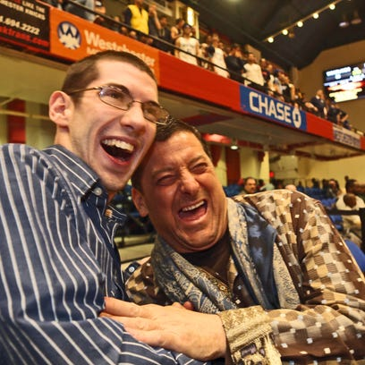 John Thompson, 21, of Pearl River, left, shares a laugh