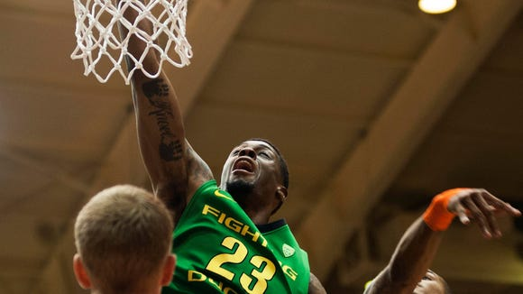 Mar 4, 2015; Corvallis, OR, USA; Oregon Ducks forward Elgin Cook (23) dunks the ball while defended by Oregon State Beavers forward Olaf Schaftenaar (30) and guard Gary Payton II (right) during the first half of the game at Gill Coliseum.