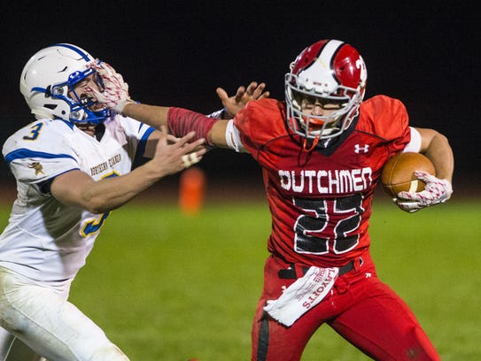 Annville-Cleona's Cameron Hoch stiff arms Northern