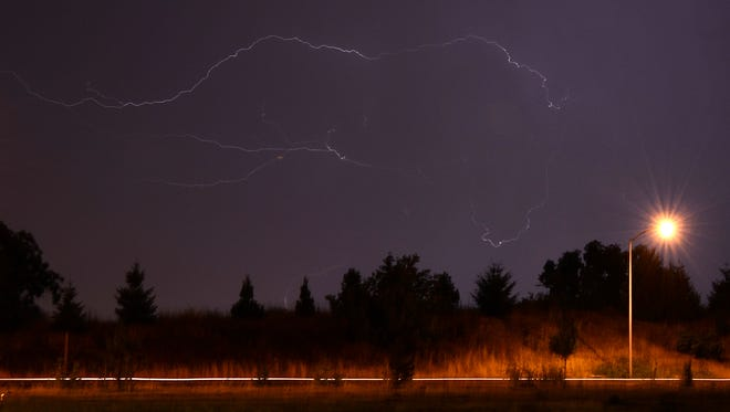 Lightning bolts flash across the sky in South Salem in 2014.