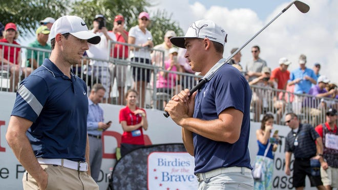Rory McIlroy and Rickie Fowler chat during the 2016 Honda Classic Pro-Am in Palm Beach Gardens.