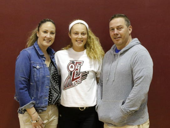 Bella Reese with her parents, Courtney Reese, and Dain