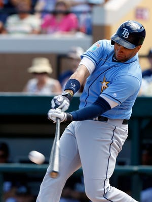 Mar 8, 2016; Lakeland, FL, USA; Tampa Bay Rays first baseman James Loney (21) hits a single during the first inning of a game against the Detroit Tigers at Joker Marchant Stadium.