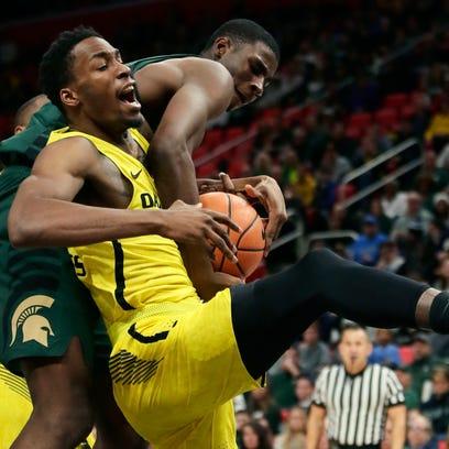 Michigan State forward Jaren Jackson Jr. reaches over