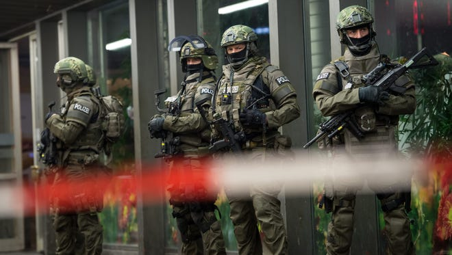 Armed German police on duty at the main railway station in central Munich, Germany, Dec. 31 2015.