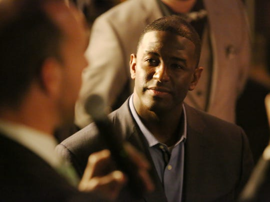Mayor Andrew Gillum listened as his friend lobbyist Adam Corey spoke at the 2015 opening of the city-backed Edison restaurant.