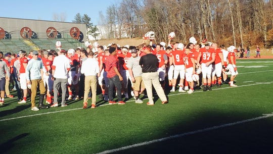 Johnnies players celebrate following Saturday afternoon's