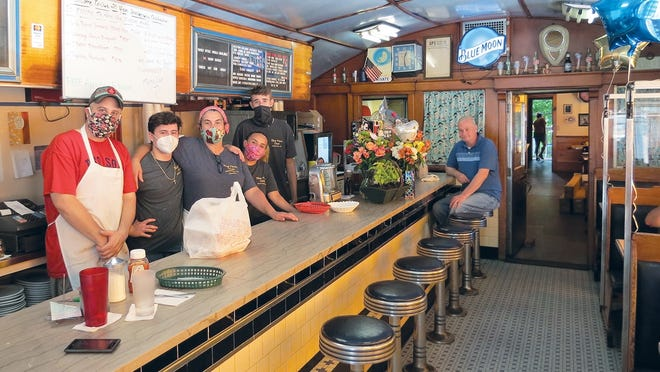 Jamie Floyd, her employees and loyal customers celebrated her 20th anniversary of running the Blue Moon Diner on July 12.