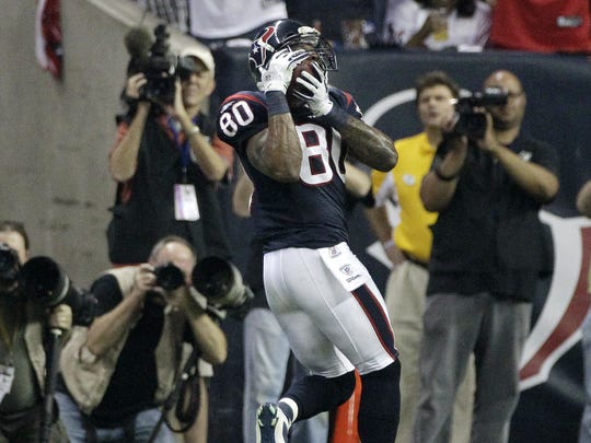 Houston Texans wide receiver Andre Johnson (80) makes a catch for a touchdown against the Cincinnati Bengals during the third quarter of an NFL wild card playoff football game Saturday, Jan. 7, 2012, in Houston.