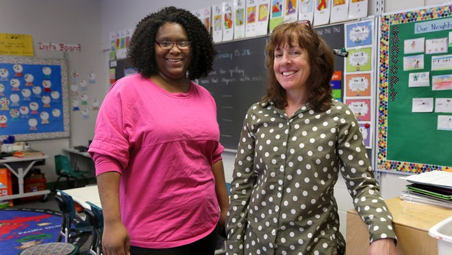 Left, Michelle Carter, 28, and first grade teacher Kathy Sergeant, 52, in her classroom, at Ronald Brown Academy, a Detroit Public School on the east side of Detroit.