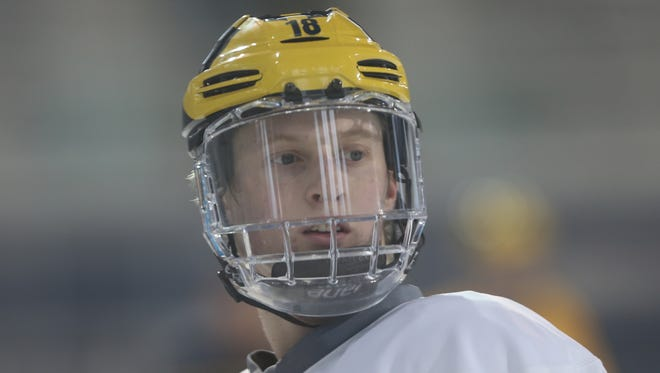 Michigan forward Kyle Connor goes through drills during practice March 3, 2016, at Yost Arena in Ann Arbor.