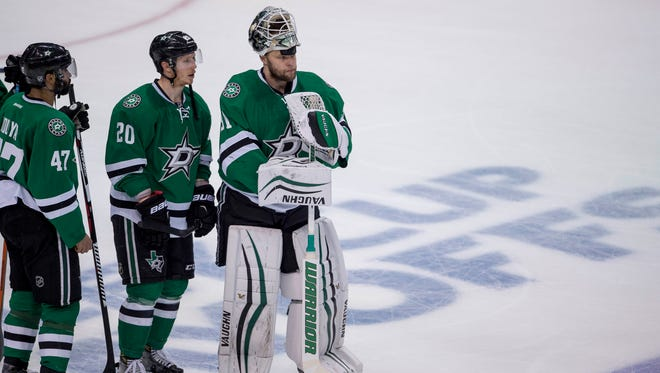 Dallas Stars goalie Antti Niemi, right, watches the St. Louis Blues celebrate after winning Game 7 of the second-round series May 11, 2016.