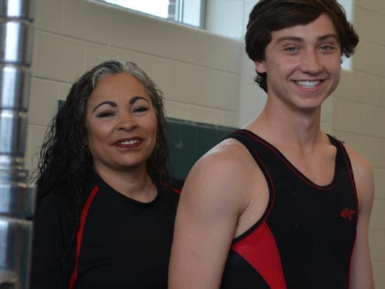 Caddo Magnet coach Julie Anderson with Johnny VanSavage