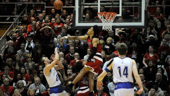 New Albany's Romeo Langford (center) blocks the shot of Castle's Jace Steller (left) on Saturday in the 2017 IHSAA 4A Regional Basketball Final at Seymour High School. Castle won 72-64. (Photo by David Lee Hartlage, Special to The Courier-Journal) Mar. 11, 2017